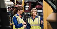 Two Women Working in a Car Manufacture Company