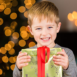 Young Boy Holding Christmas Gift
